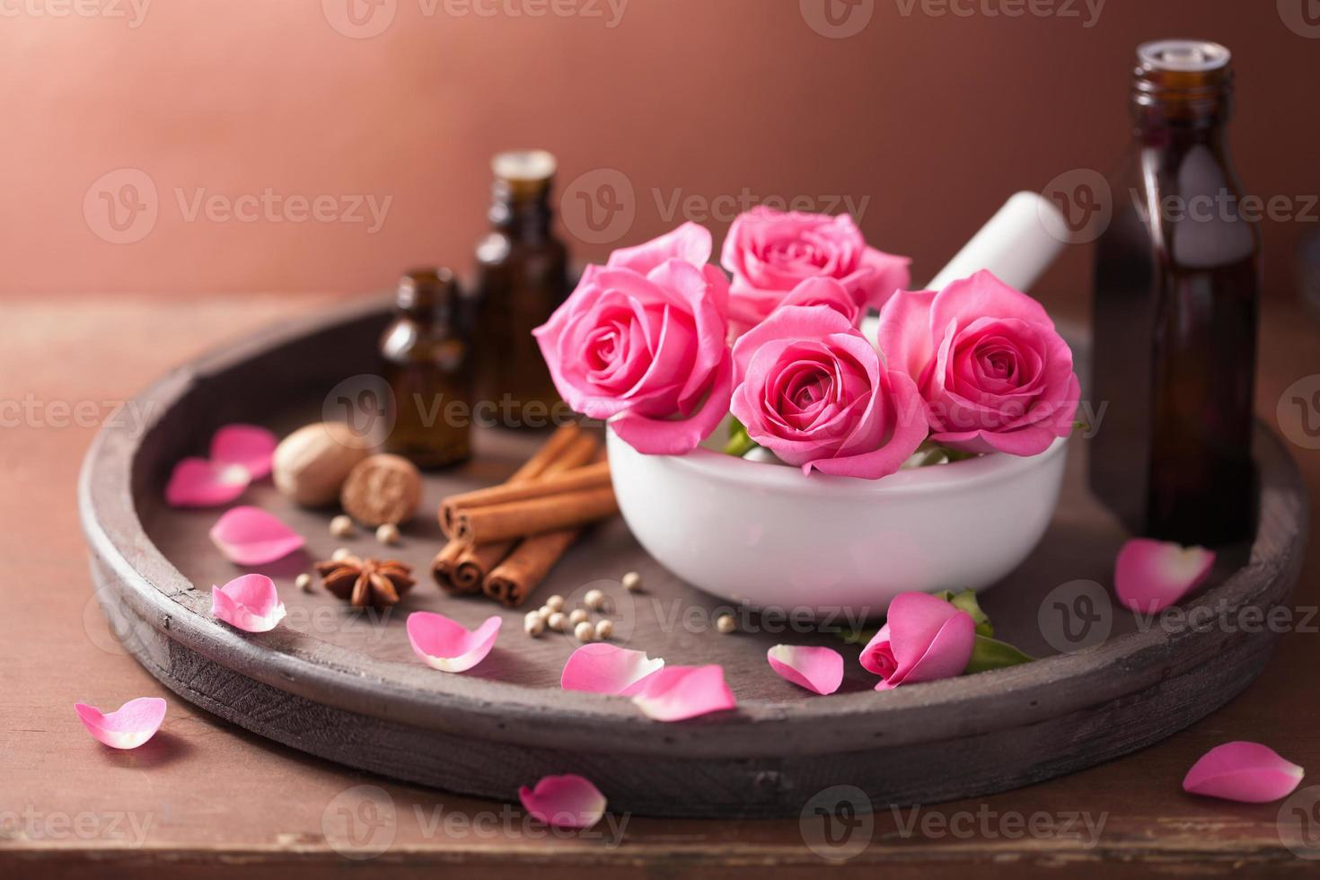 spa and aromatherapy set with rose flowers mortar, spices photo
