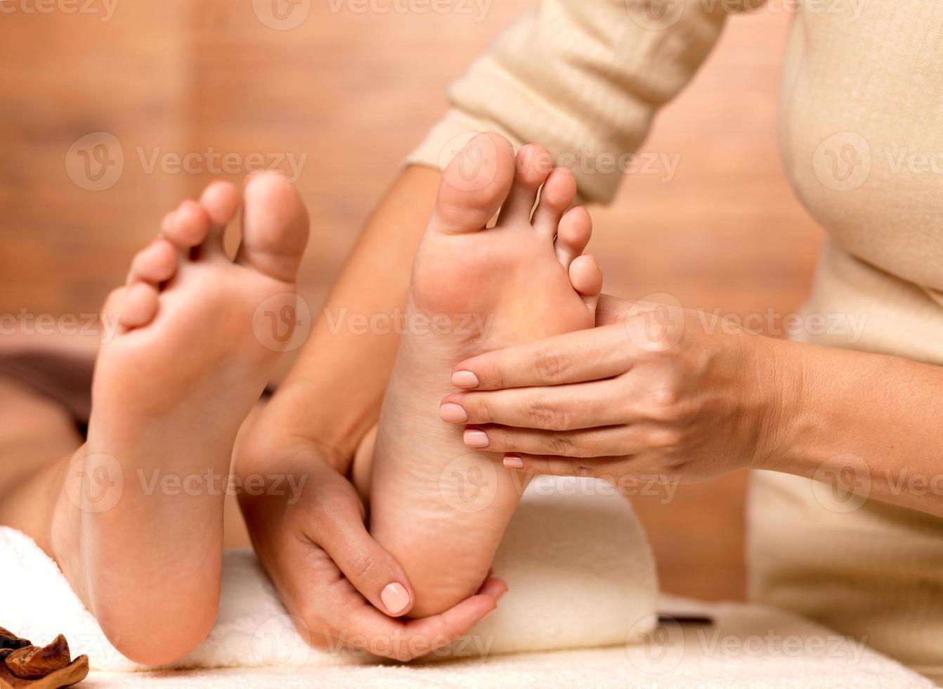Massage of human foot in spa salon photo