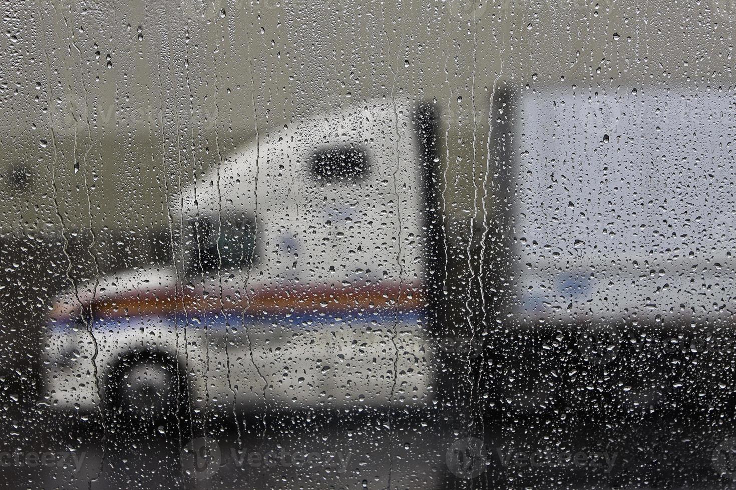 semi truck in the rainy windshield photo