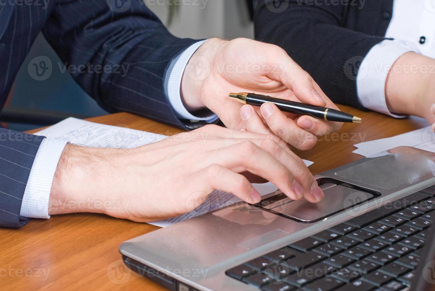 Businessman with laptop photo