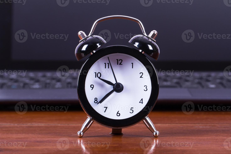 Alarm Clock and Laptop photo