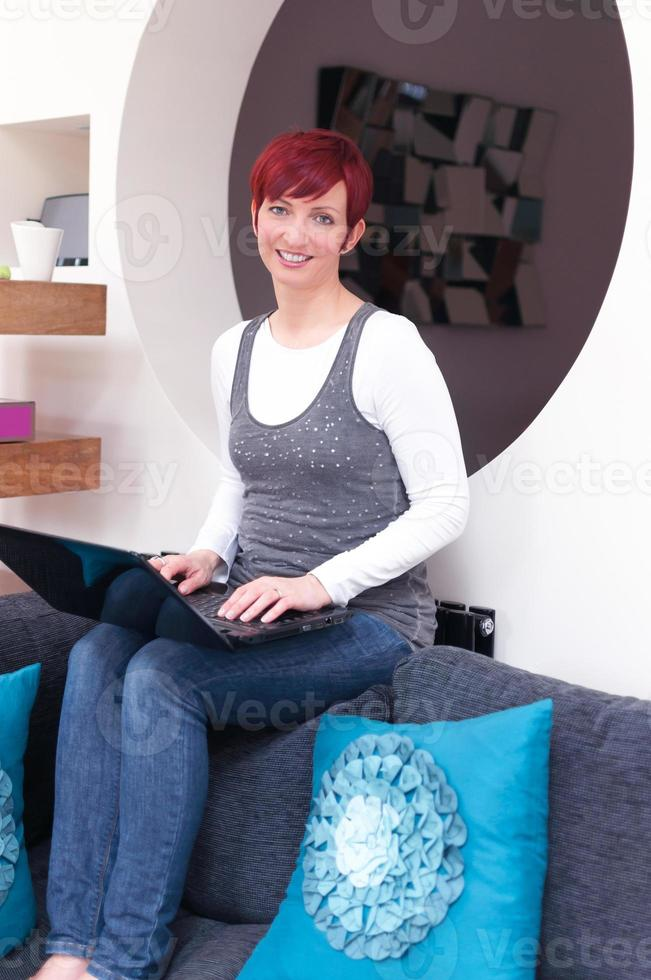 Woman working at contemporary home photo