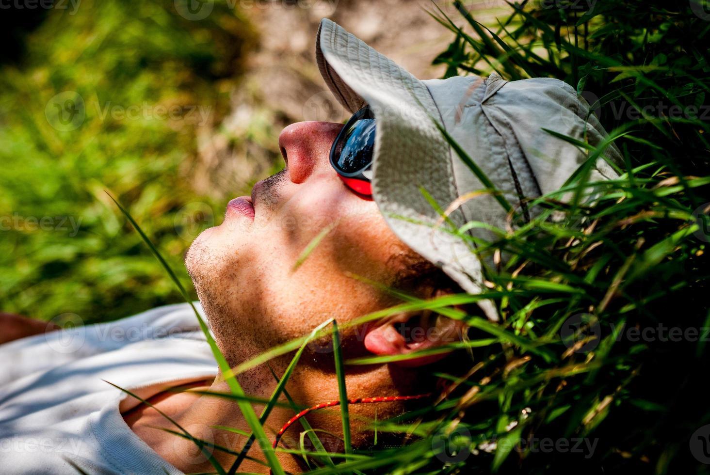 Man sleeping on the grass, Hiking photo
