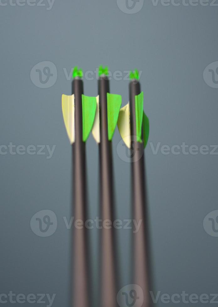Three arrows with a shallow depth of field photo