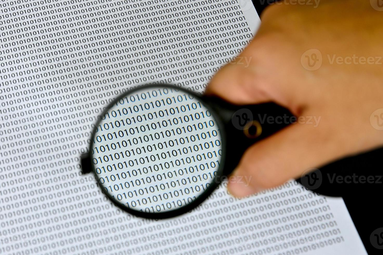 Magnifying glass with success word on background . photo