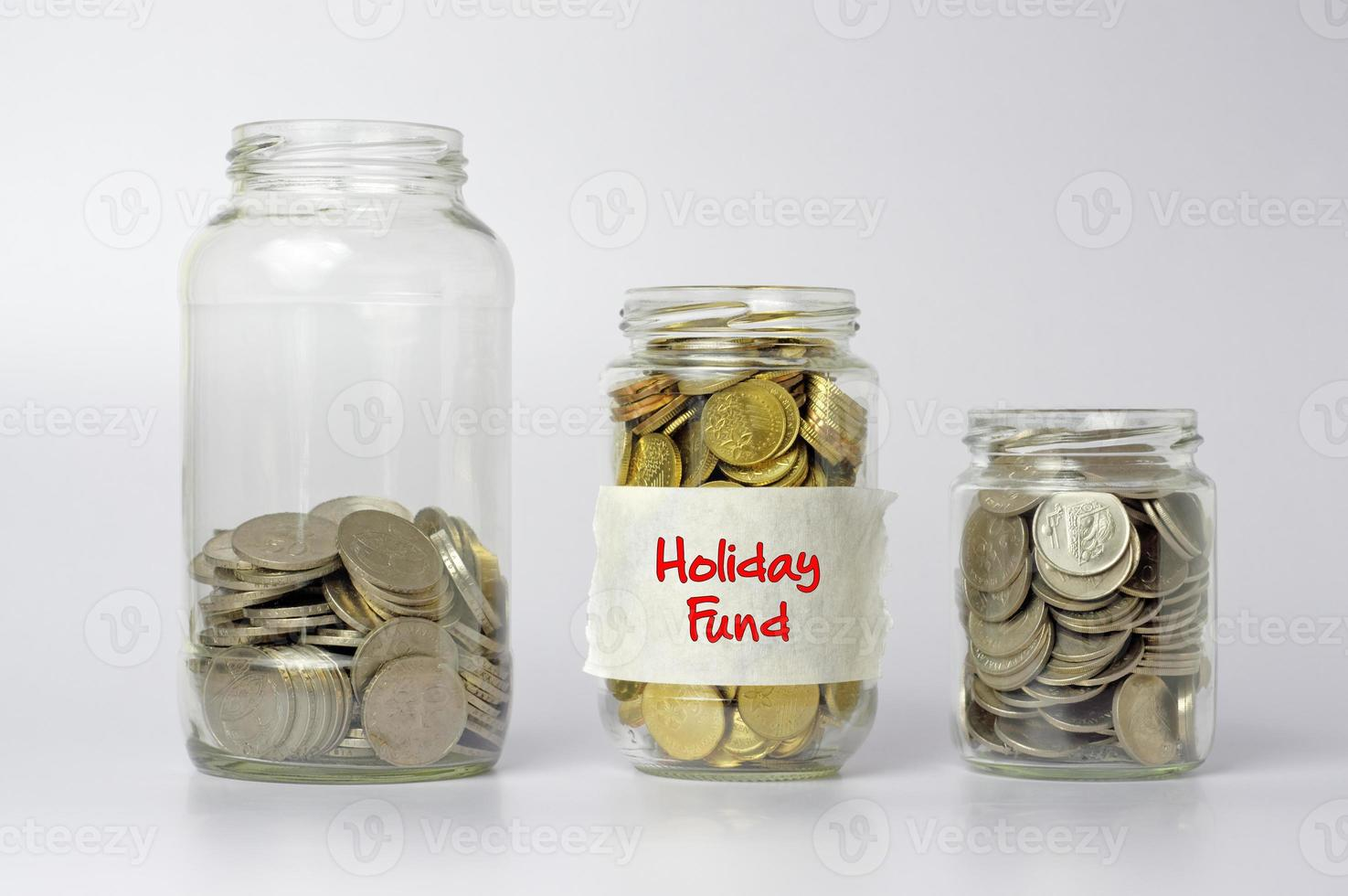 Coins in Three Different Size of Jar - Financial Concept photo