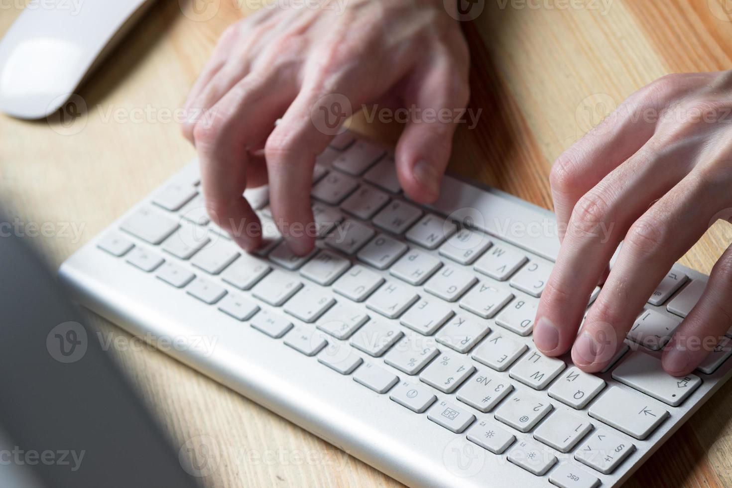 close up of typing man hands photo