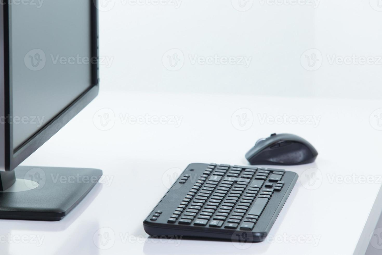 Monitor with a keyboard and mouse photo