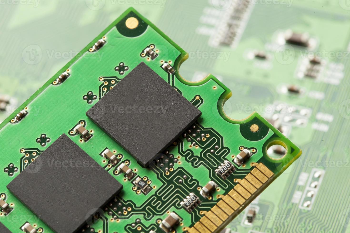 Green Electrical Circuit Board with microchips and transistors photo