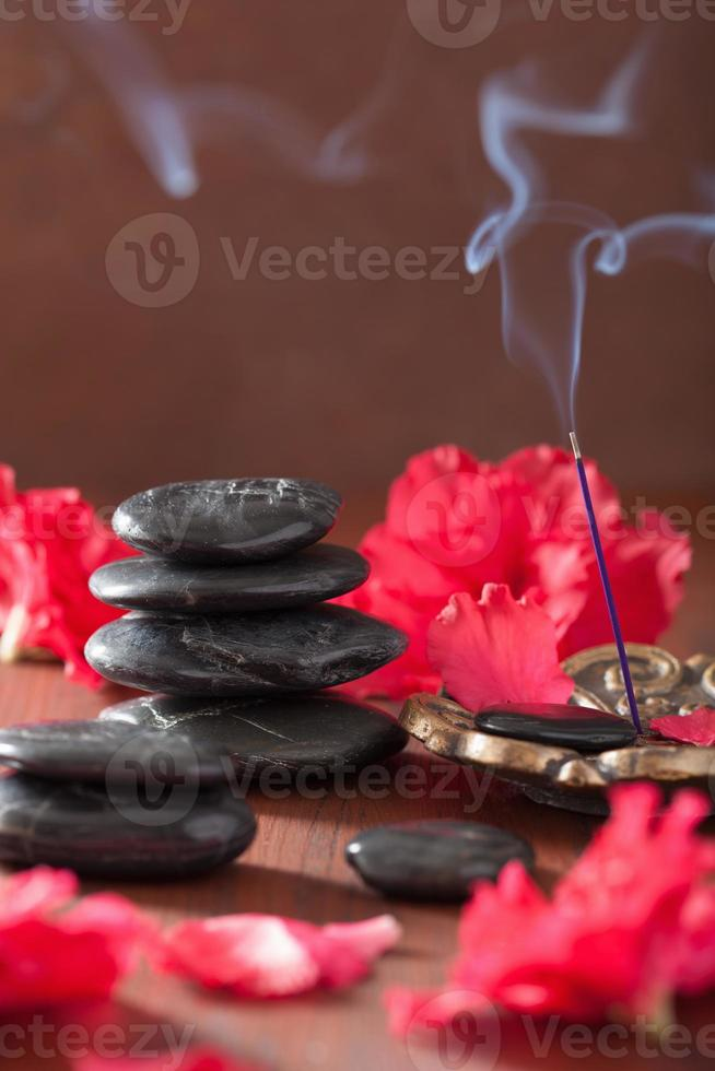azalea flowers black massage stones incense sticks for aromather photo