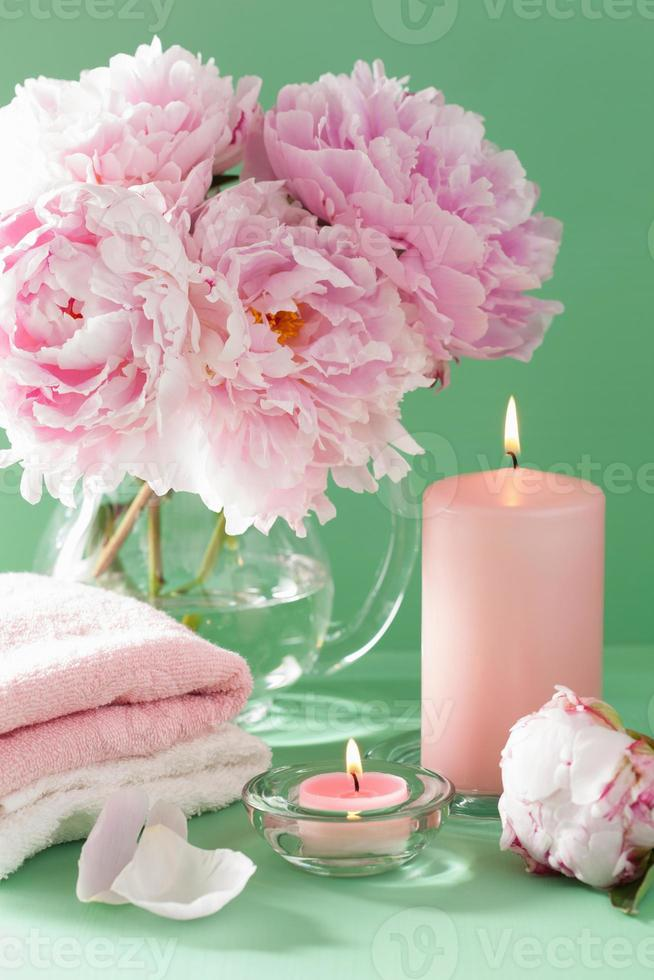 bath and spa with peony flowers candles towels photo