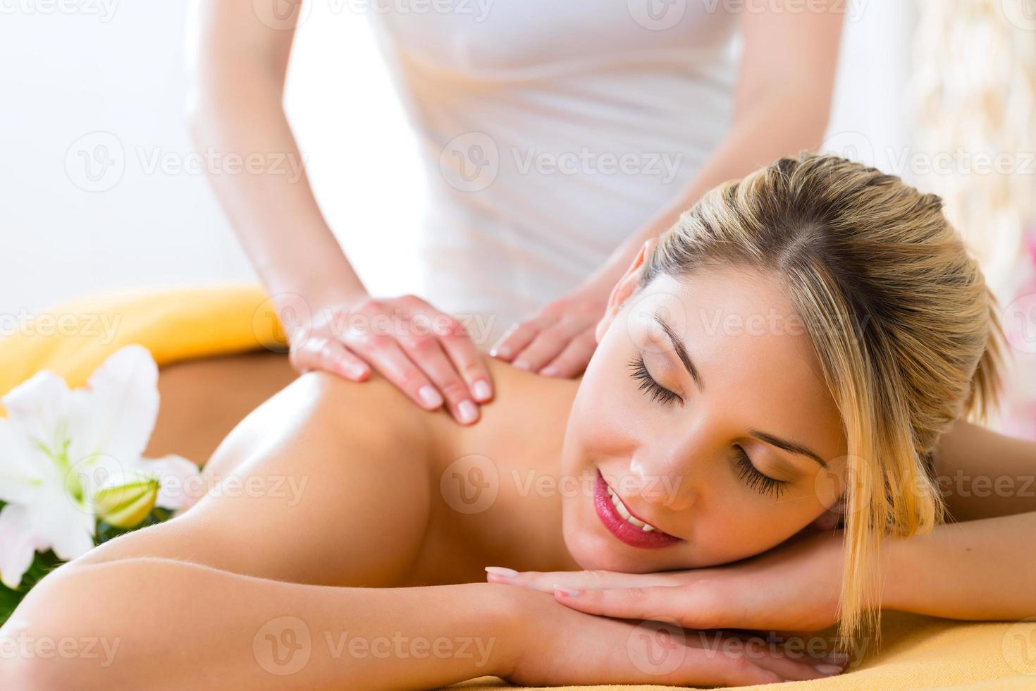 Wellness - woman getting body massage in Spa photo