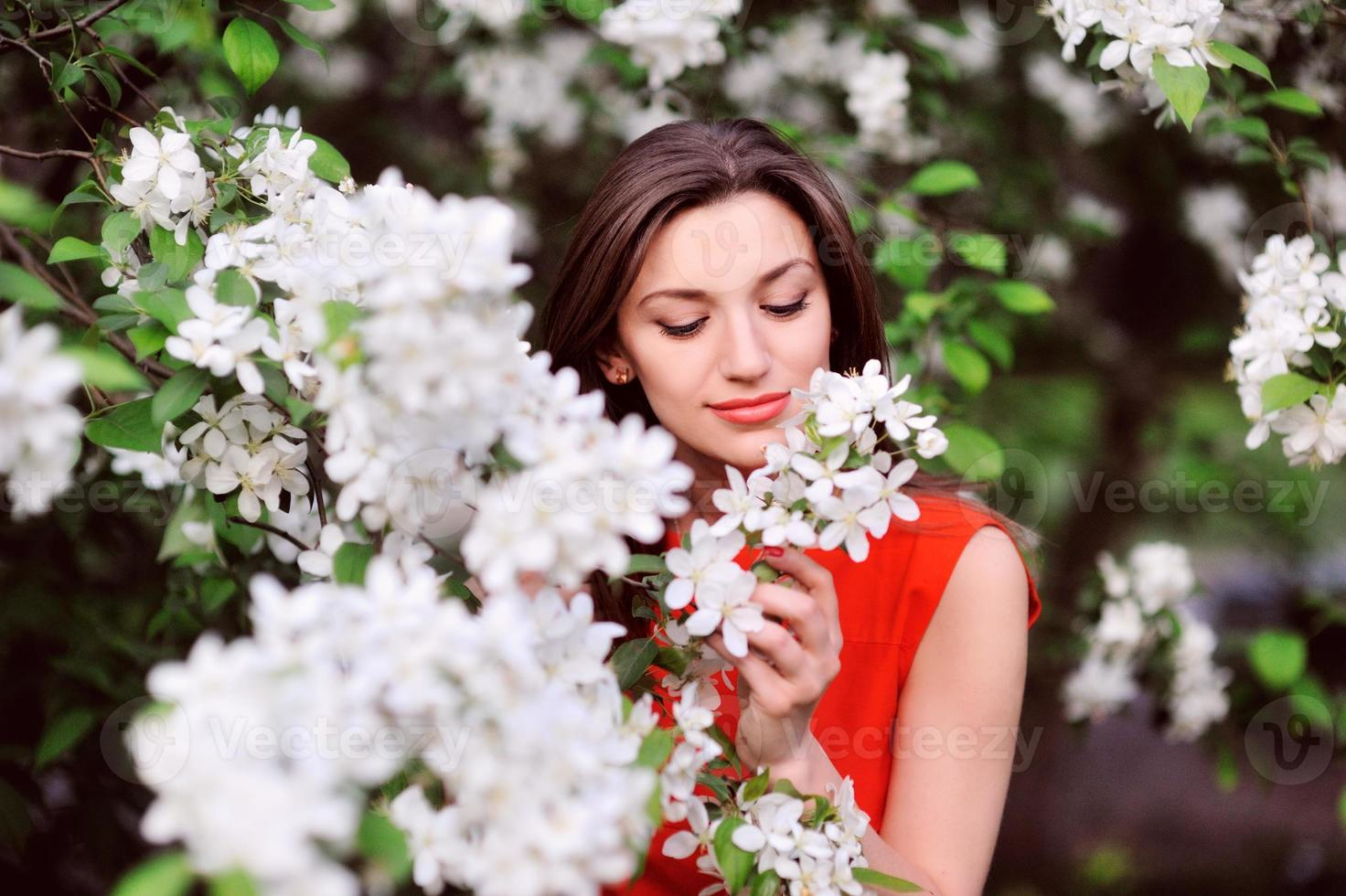 Beautiful Spring Girl with flowers photo