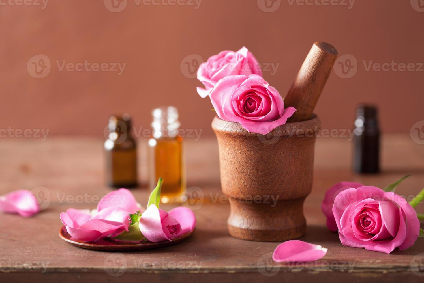 spa set with rose flowers mortar and essential oil photo