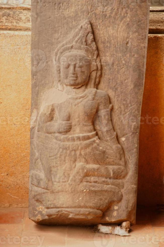 Ancient Buddha Carving on sandstone . photo