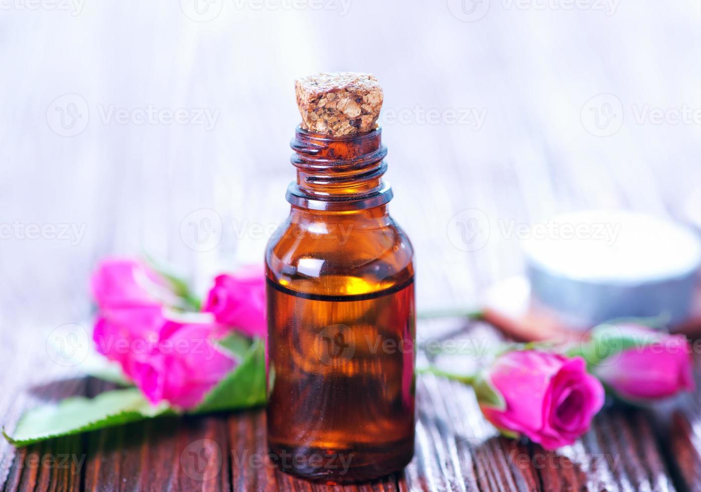 rose oil in bottle photo
