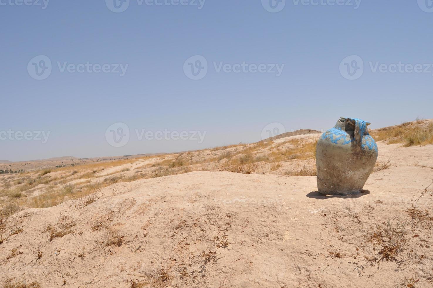 Decorative pitcher in the desert. Sahara. photo