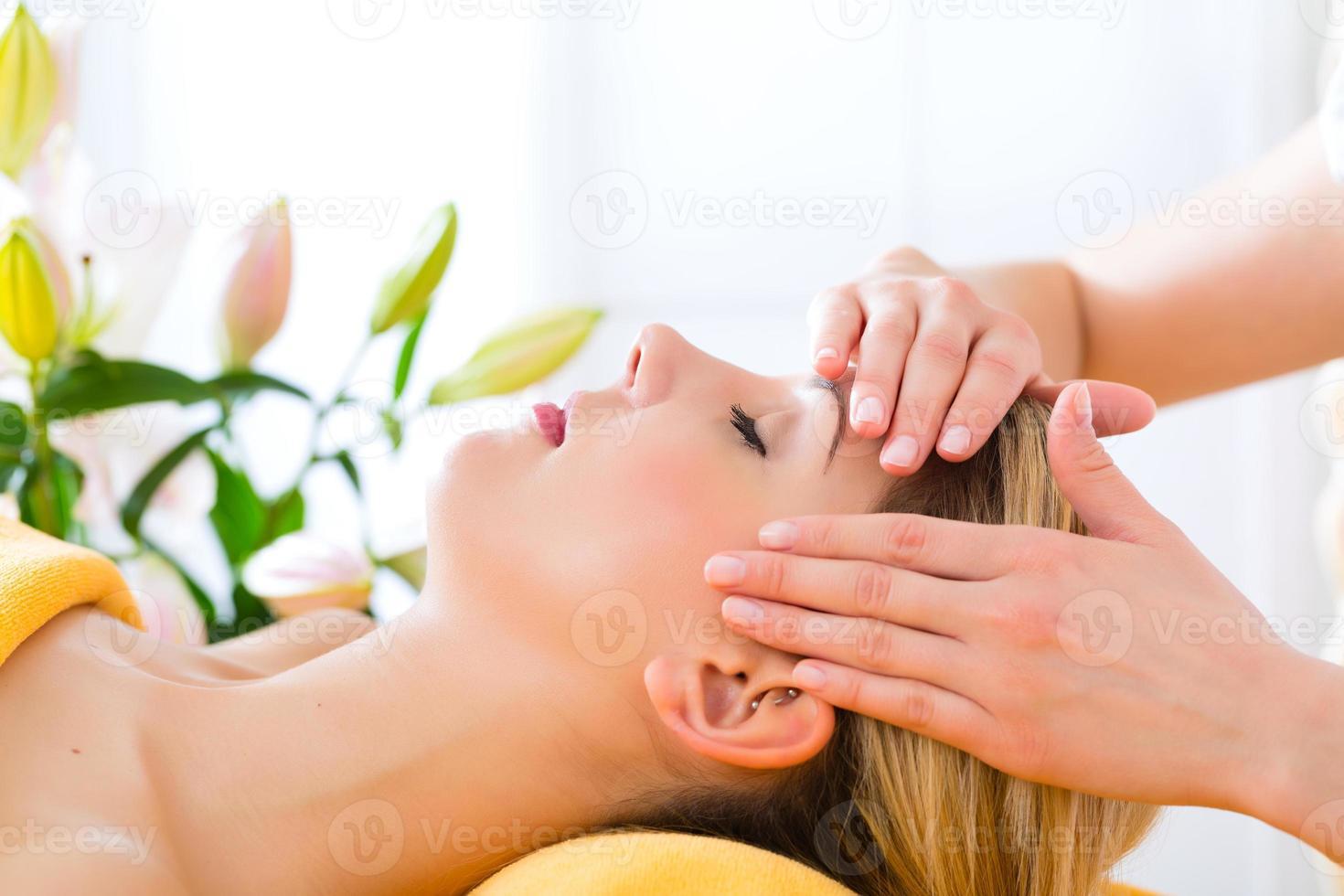 Wellness - woman getting head massage in Spa photo