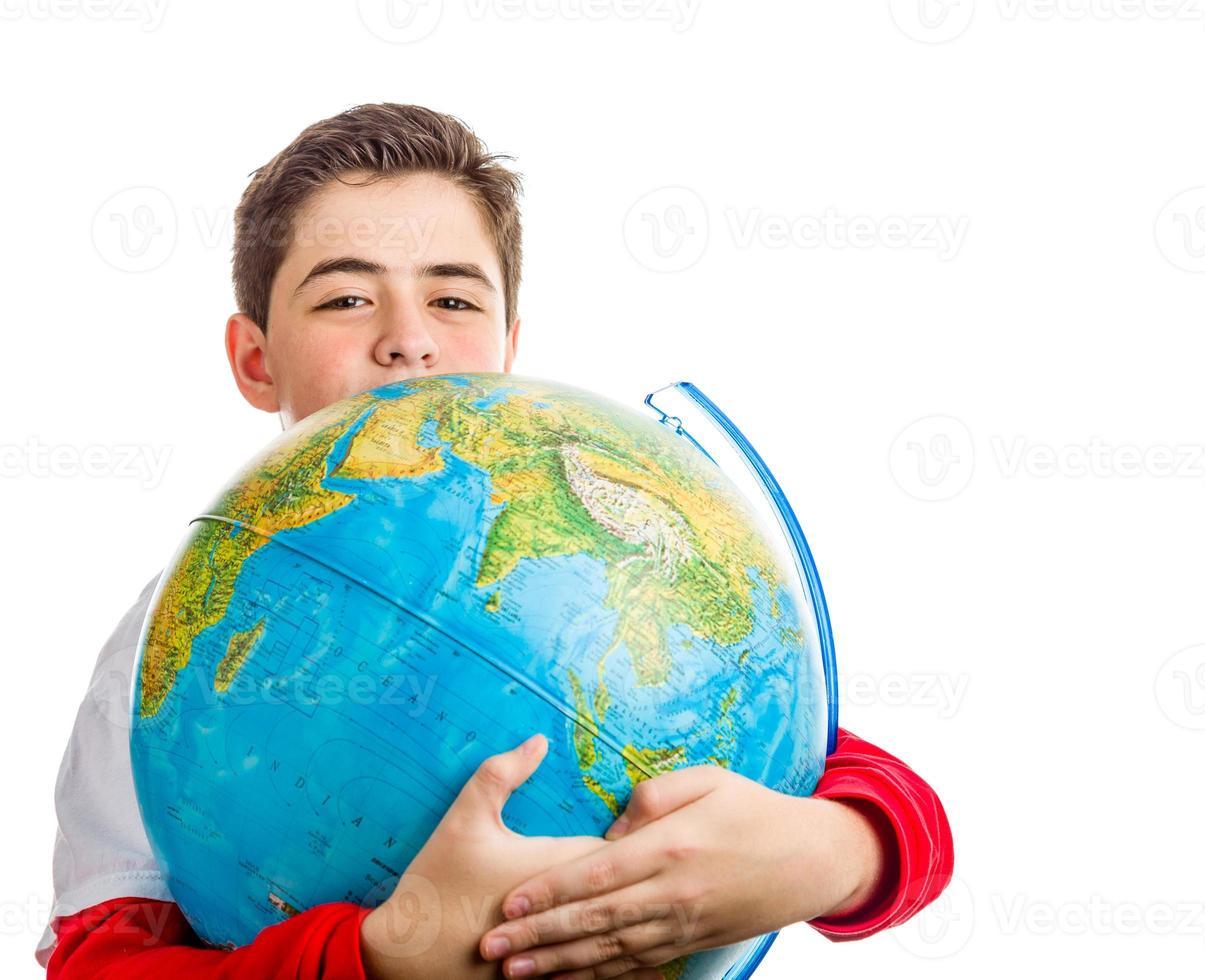 Caucasian boy hugs globe photo