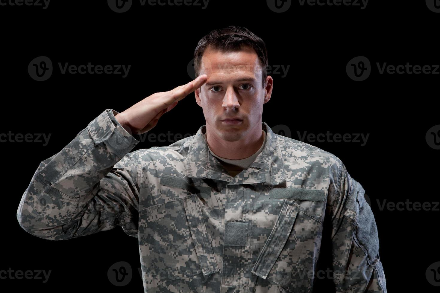 Caucasian soldier salutes photo