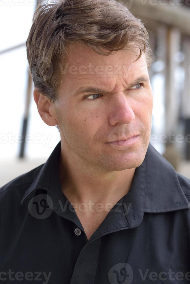 Handsome Caucasian man in deep thought photo