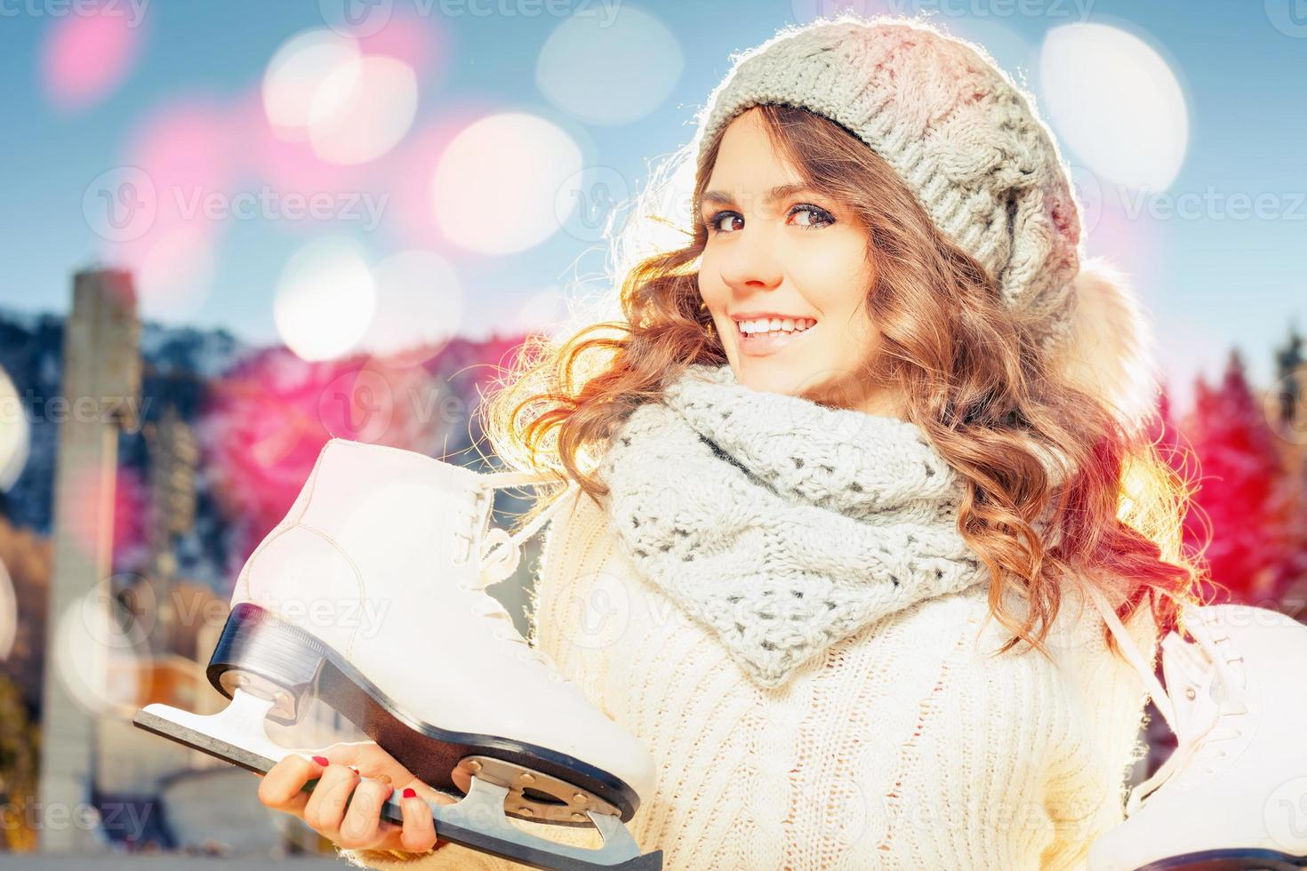 Beautiful caucasian woman going to ice skating outdoor photo