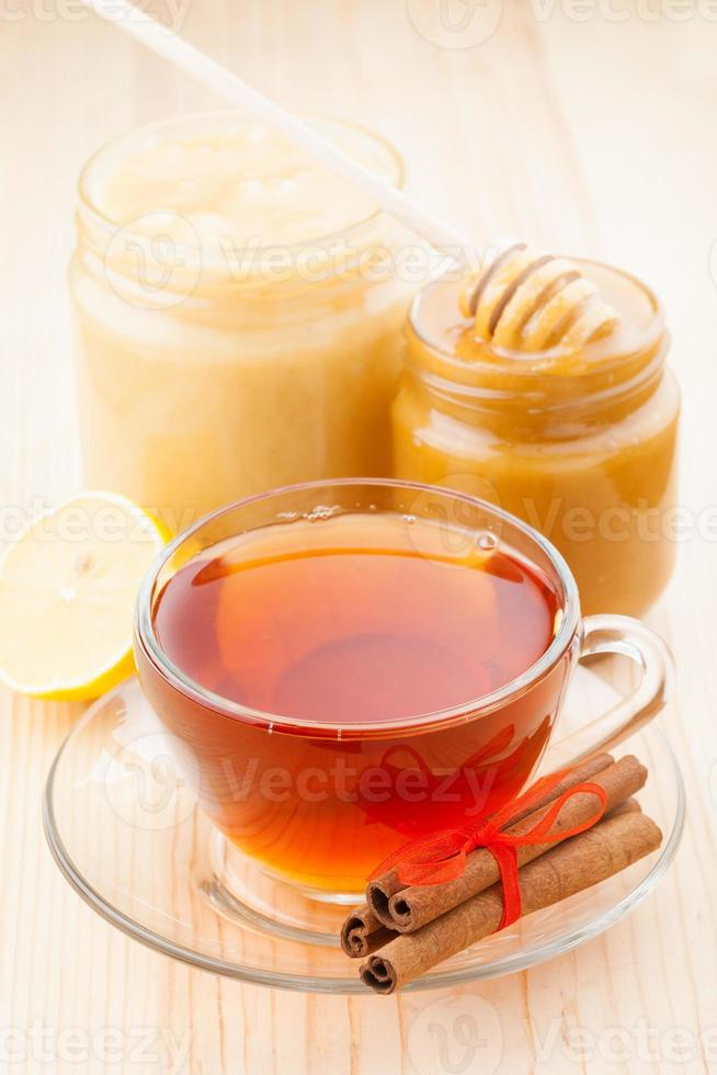 honey  and cup of healthy tea photo