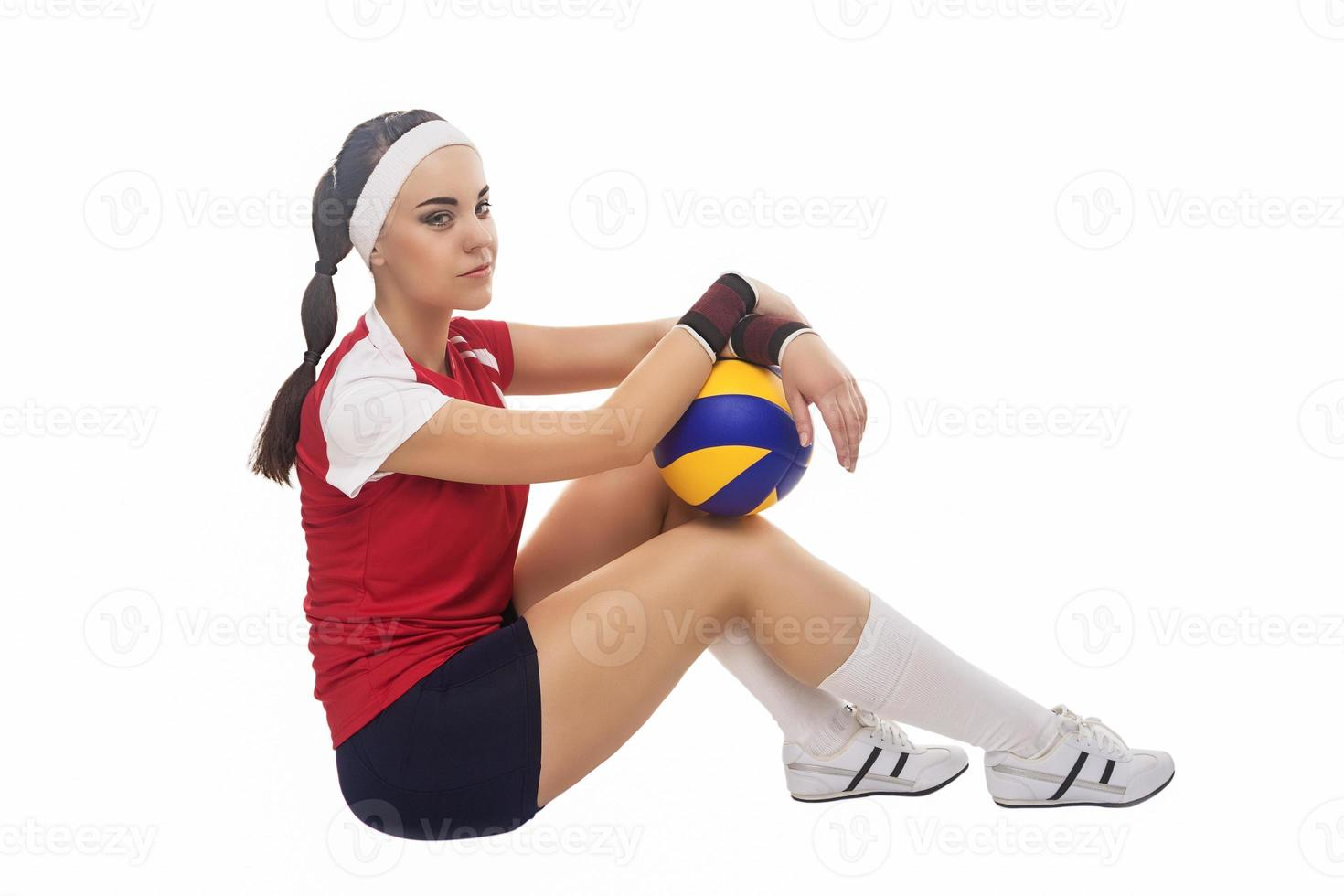 Portrait of Caucasian Professional Female Volleyball Player Equipped in Volleyball Outfit photo
