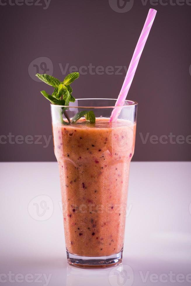 Glass of banana with blackberry smoothie photo