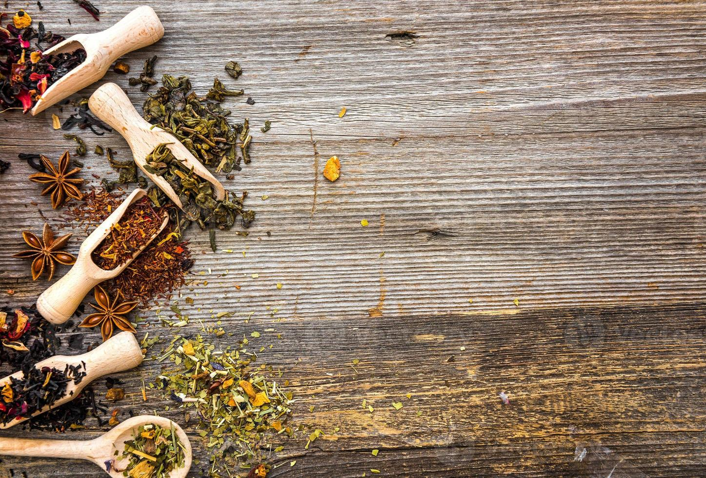 dry teas on wooden background photo