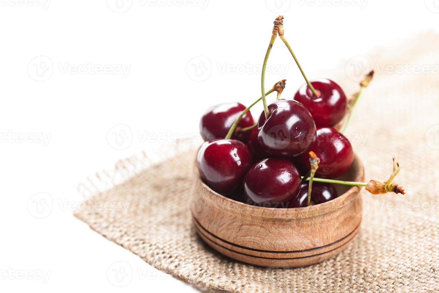cherries in wooden bowl photo