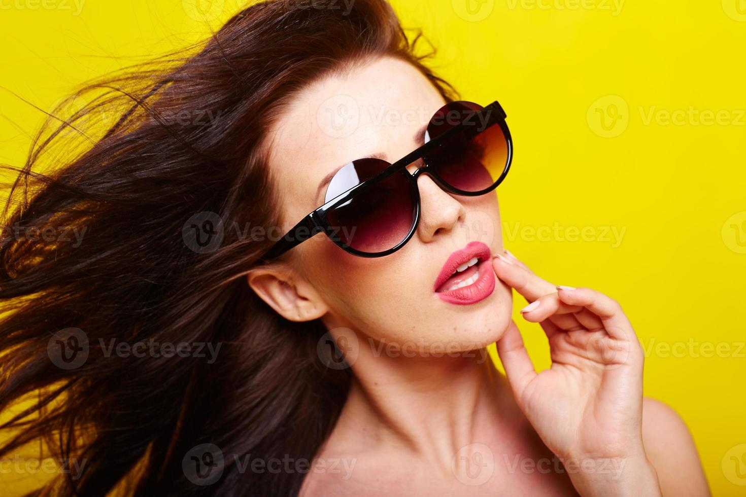 young gorgeous caucasian woman wearing sunglasses photo