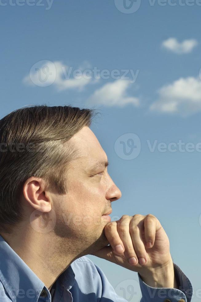 Thoughtful man on nature photo