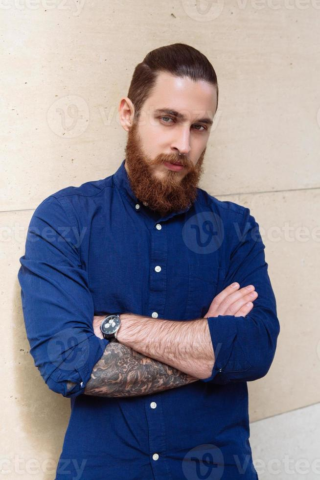 Bearded hipster in the city photo