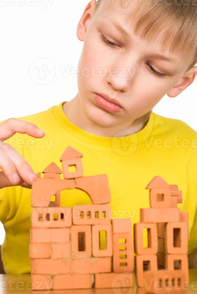 young boy constructing photo