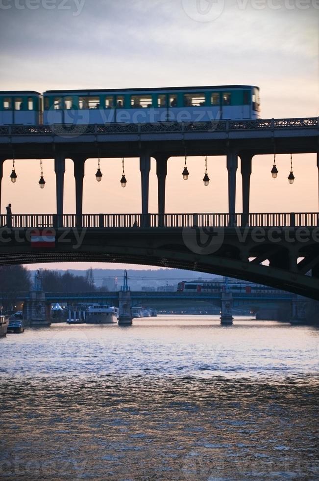 Bir Hakeim Bridge with metro and silhouette photo