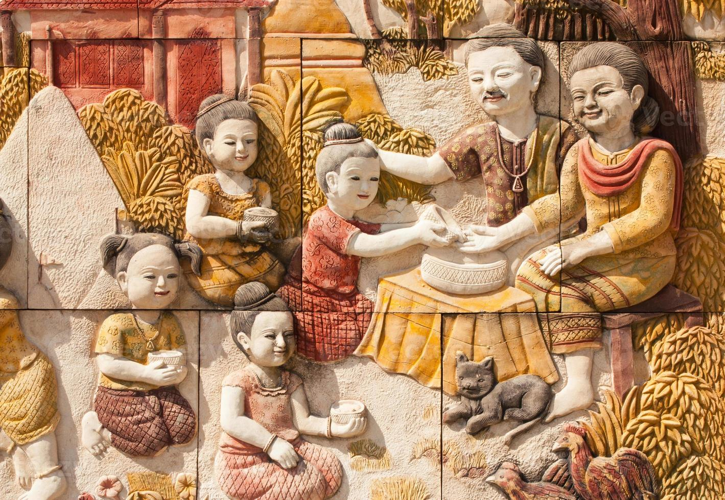 Stone carving of Thai culture of Songkran festival photo