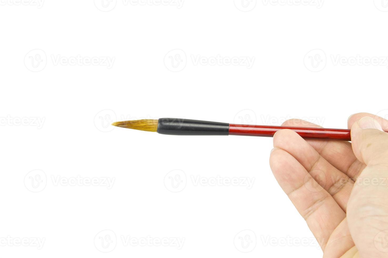 Man Holding Chinese writing brush on middle isolate white background photo