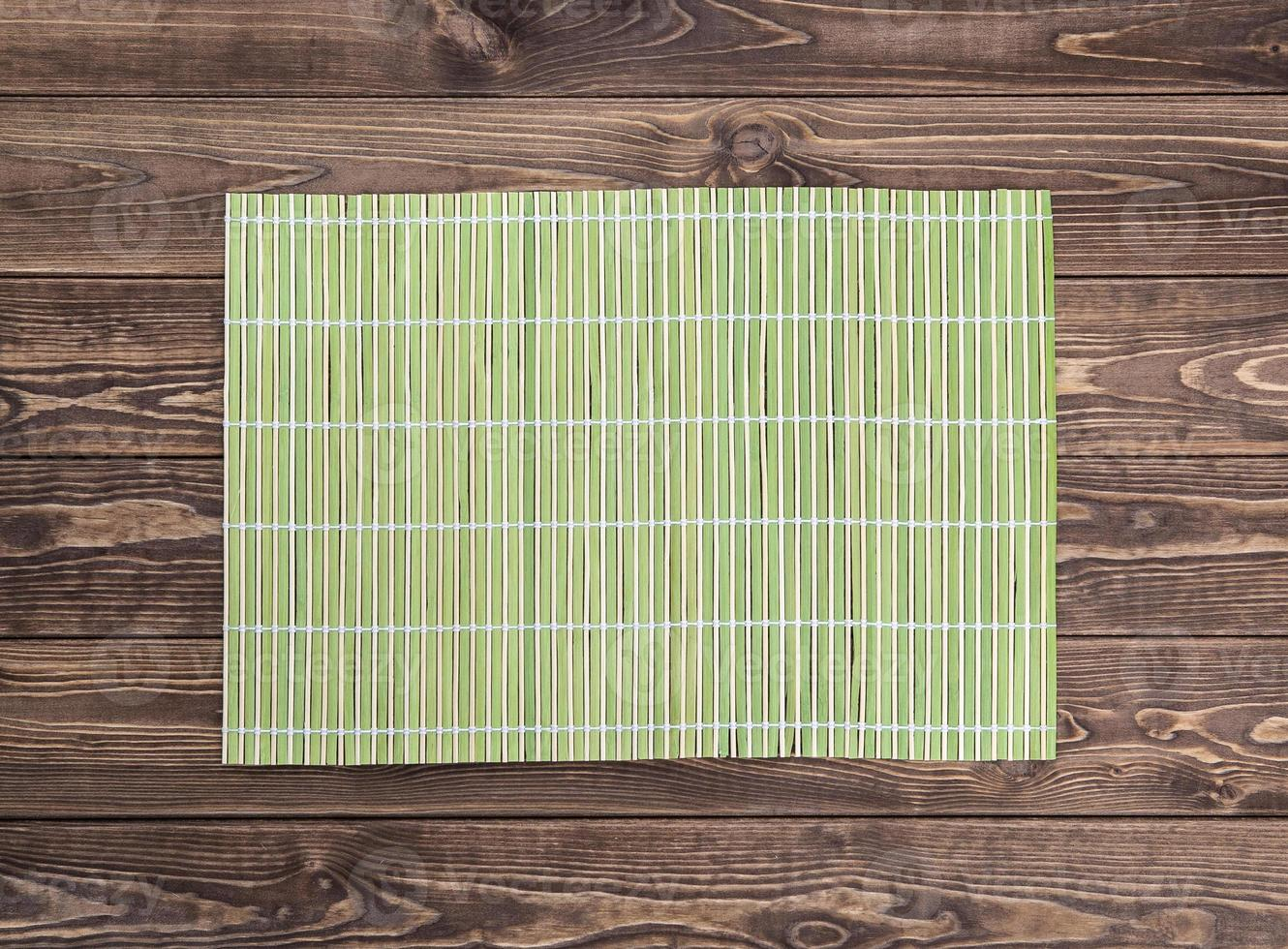 bamboo napkin on wooden table. top view photo