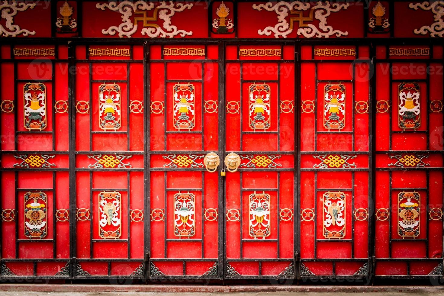 Traditional Chinese gateway with folding doors. photo