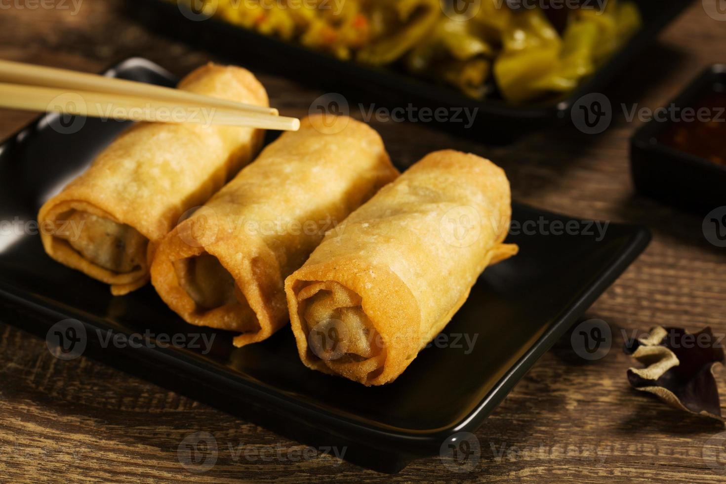 Baked spring rolls with deep, vegetables and rice. photo