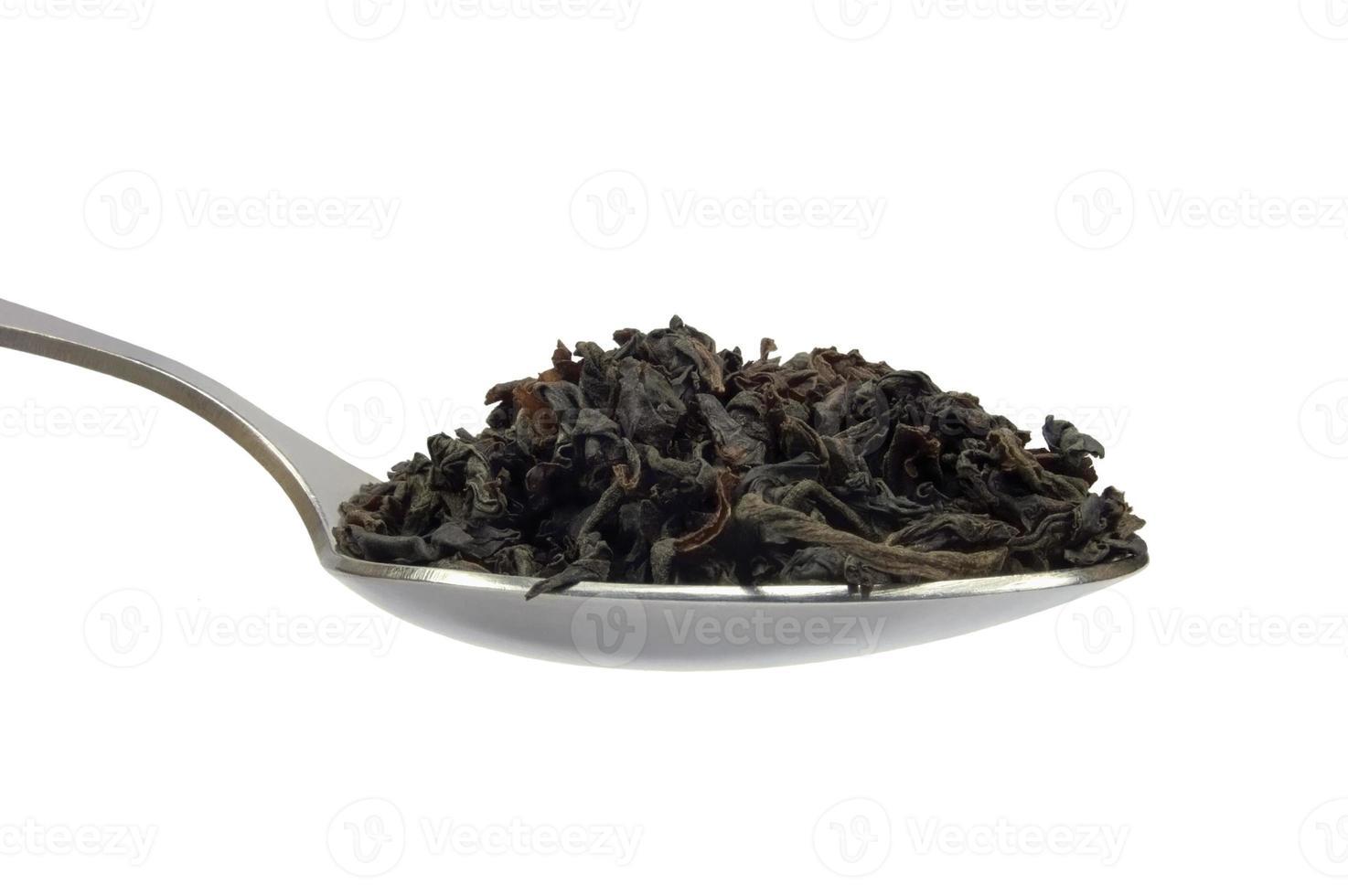 Teaspoom black tea leaf, isolated spoonful macro closeup, detailed spoon photo