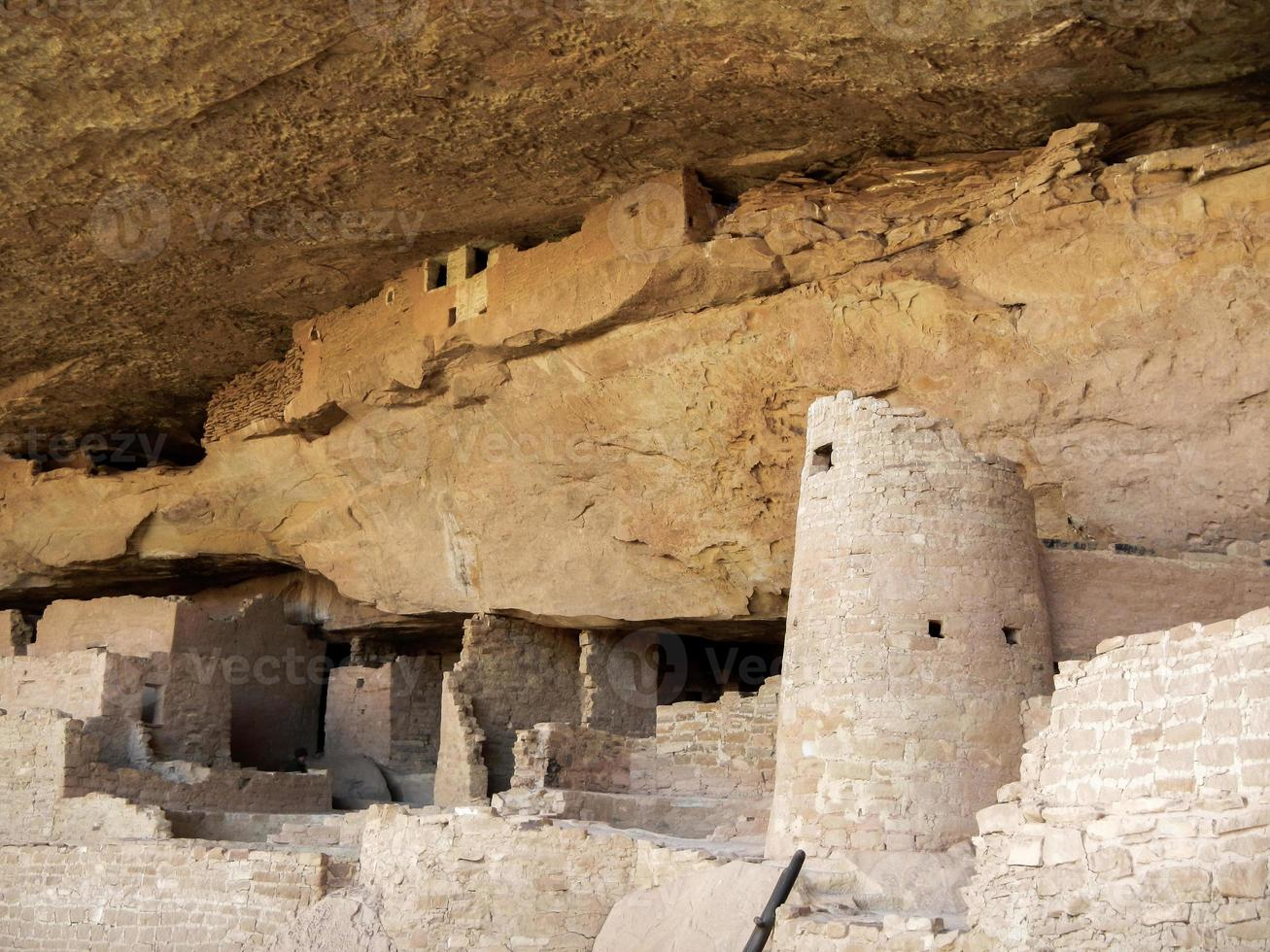 The abandoned dwellings under the cliff ceiling photo