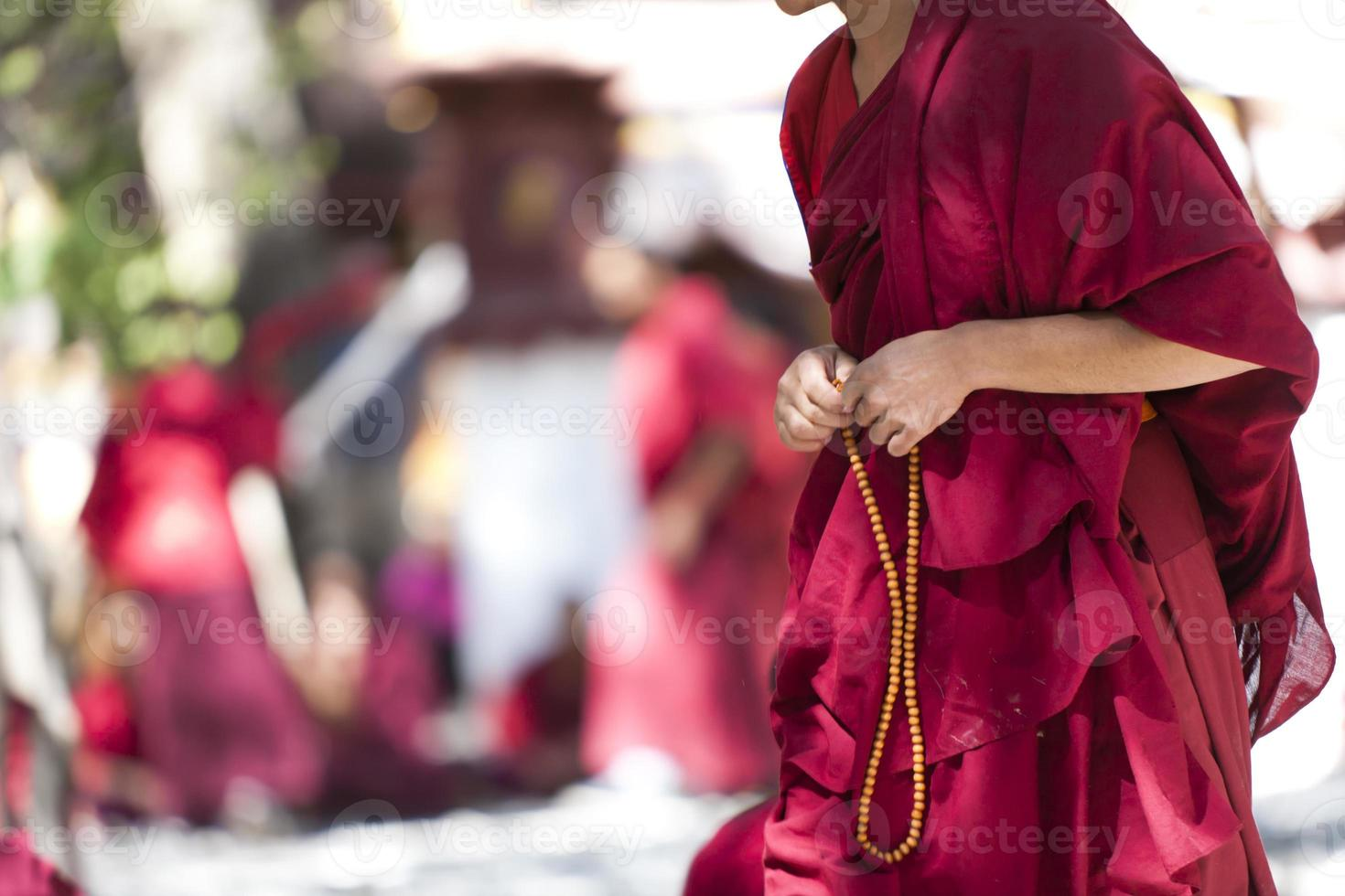 monk with prayer beads photo