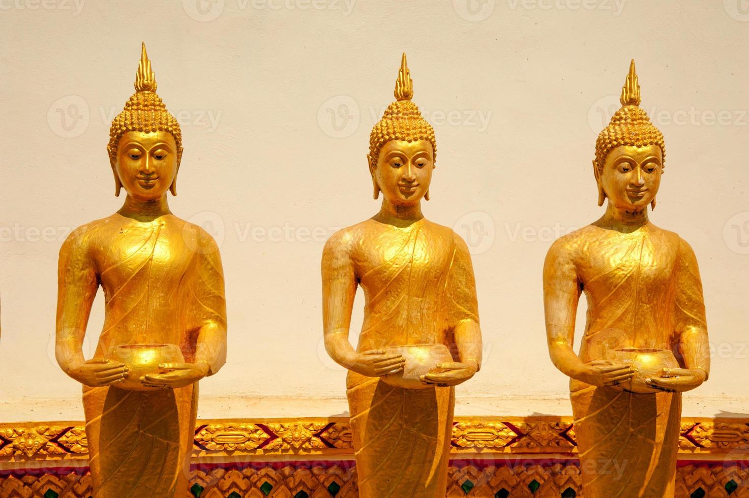 Golen buddhas buddhist culture and life style temple statues Asi photo