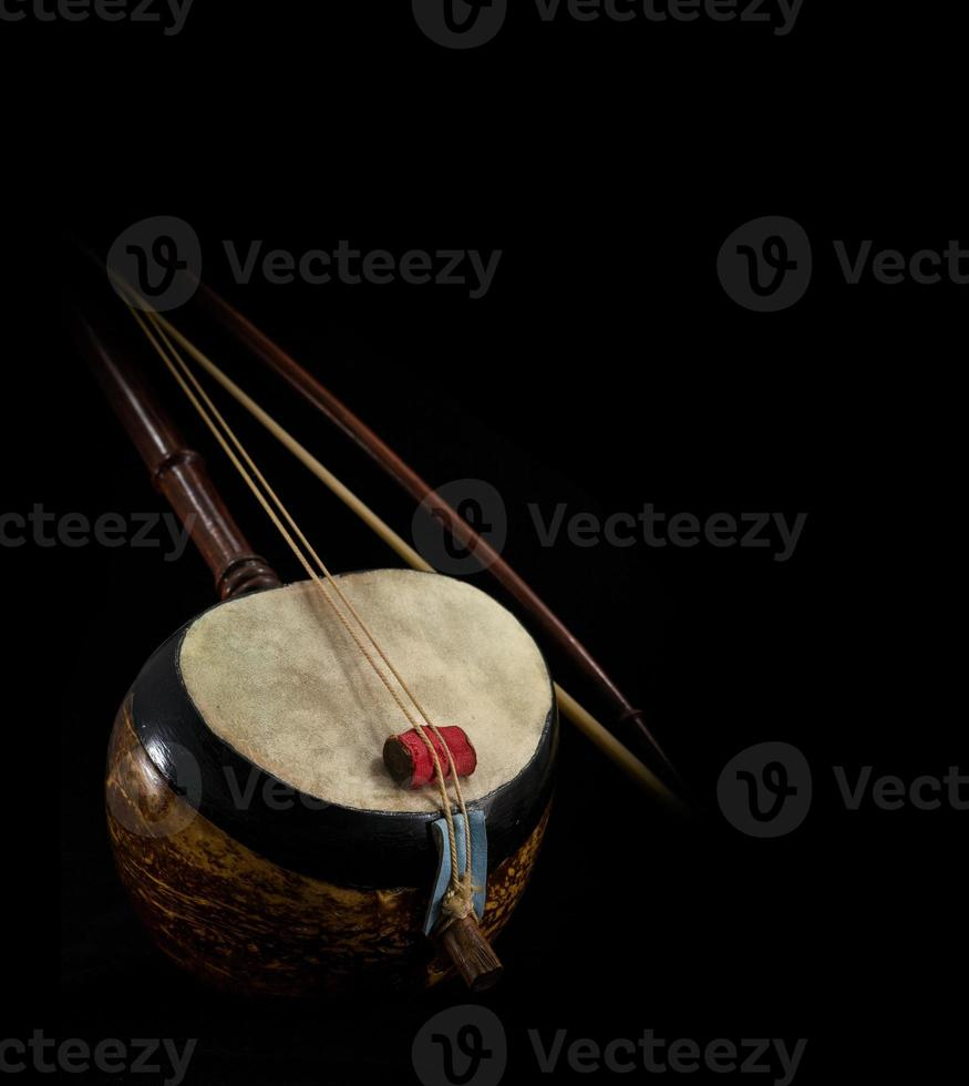 part of Saw, Thai fiddle bass sounded string music instrument photo