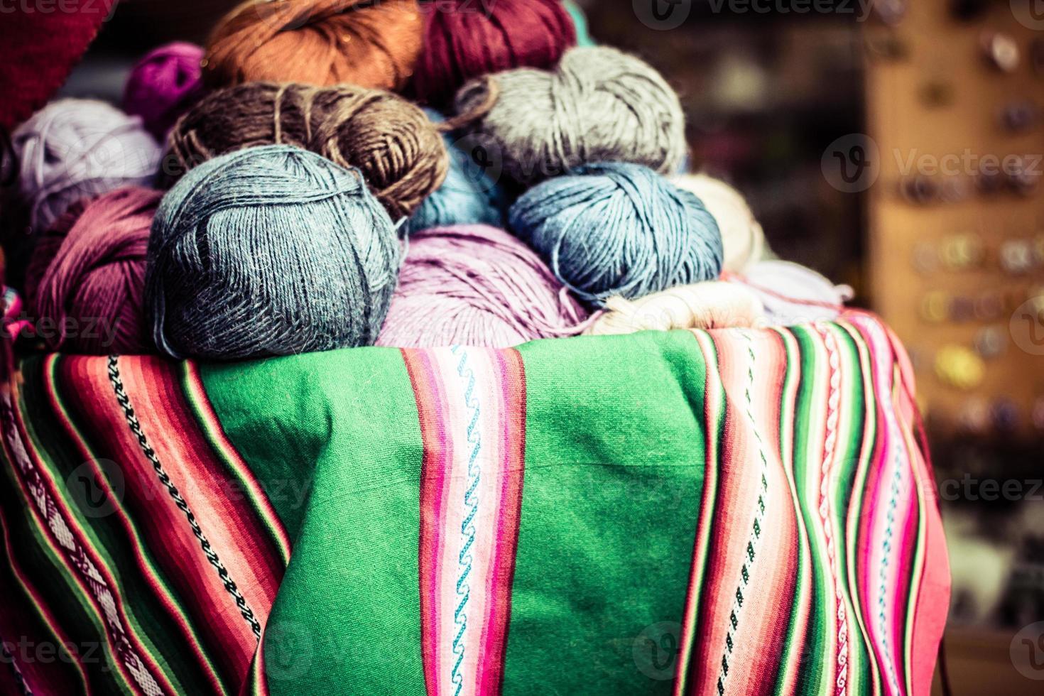 Colorful Fabric at market in Peru, South America photo