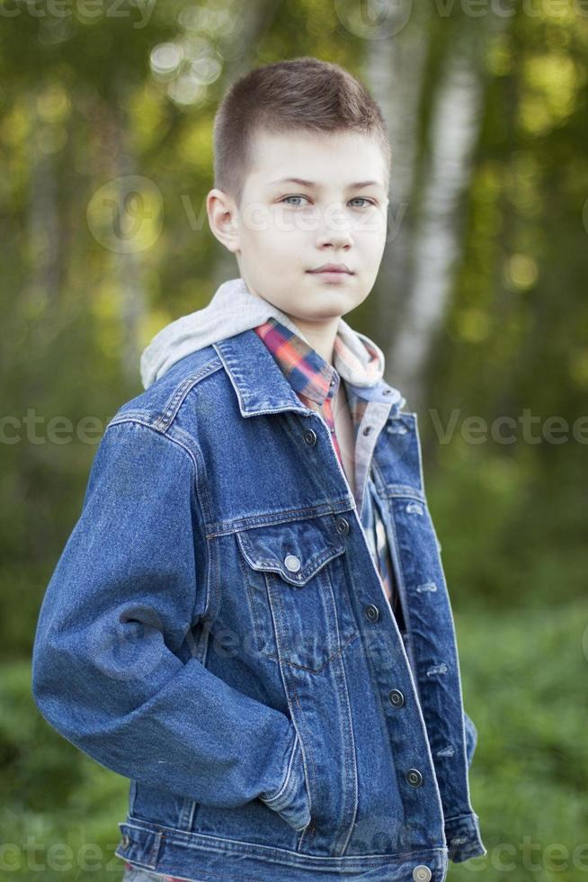 Young boy standing in the park photo
