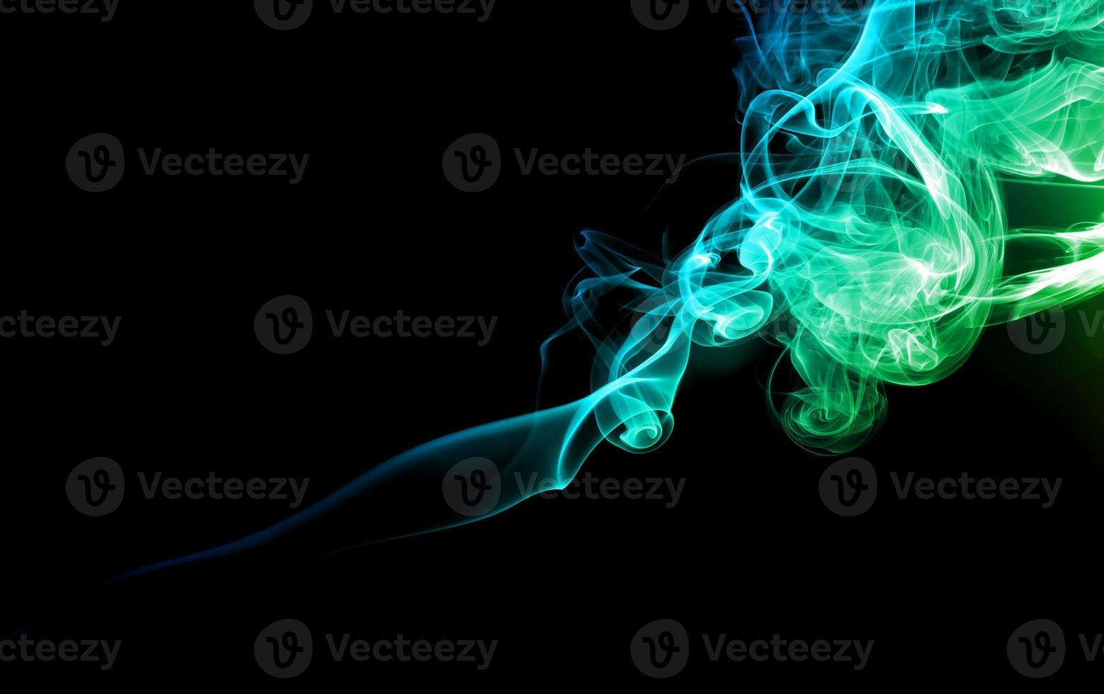 Green and blue smoke on dark photo
