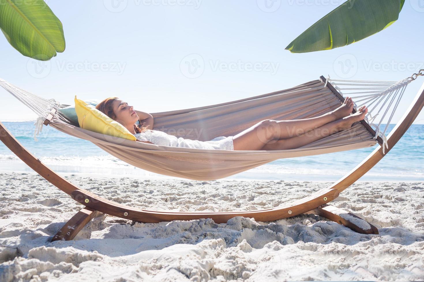 Brunette relaxing in the hammock photo